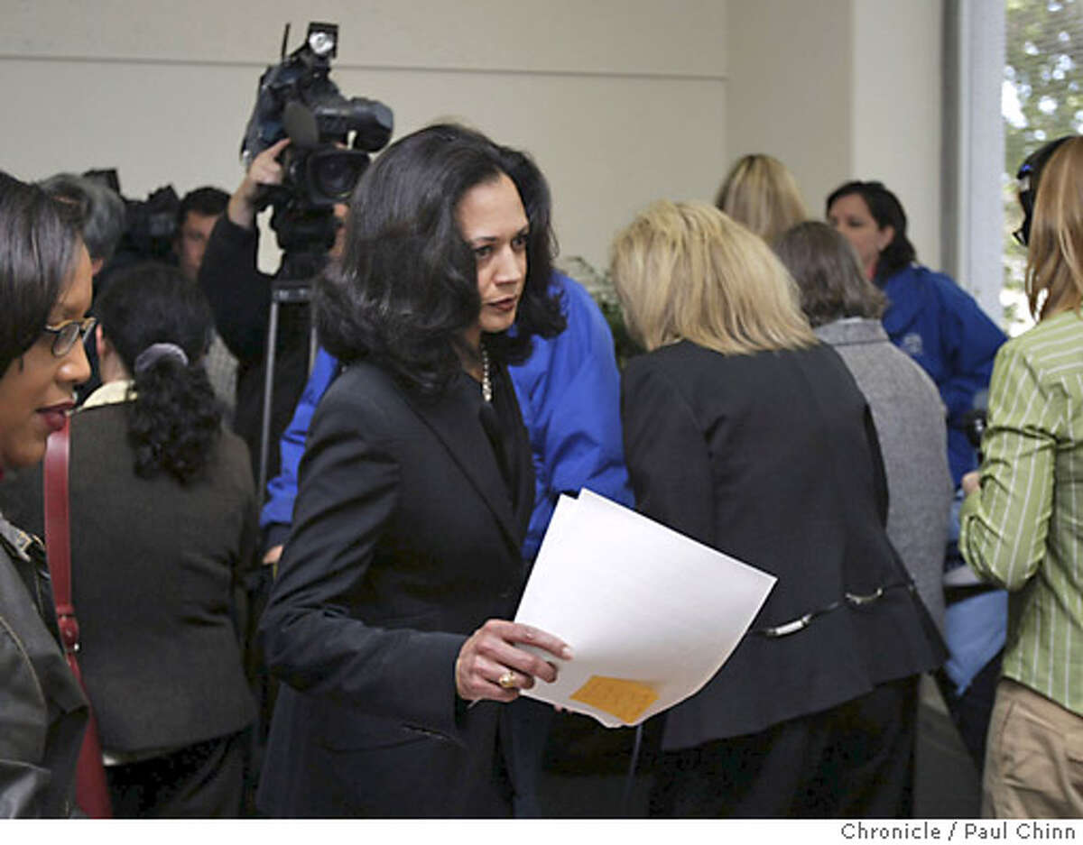 District Attorney Kamala Harris negotiates her way back to her desk after announcing at a crowded news conference that she will not change her mind about not seeking the death penalty. The SF Police Officer's Association and DA Kamala Harris hold separate news conferences to comment on police officer Isaac Espinoza's shooting death on 4/21/04 in San Francisco. PAUL CHINN/The Chronicle