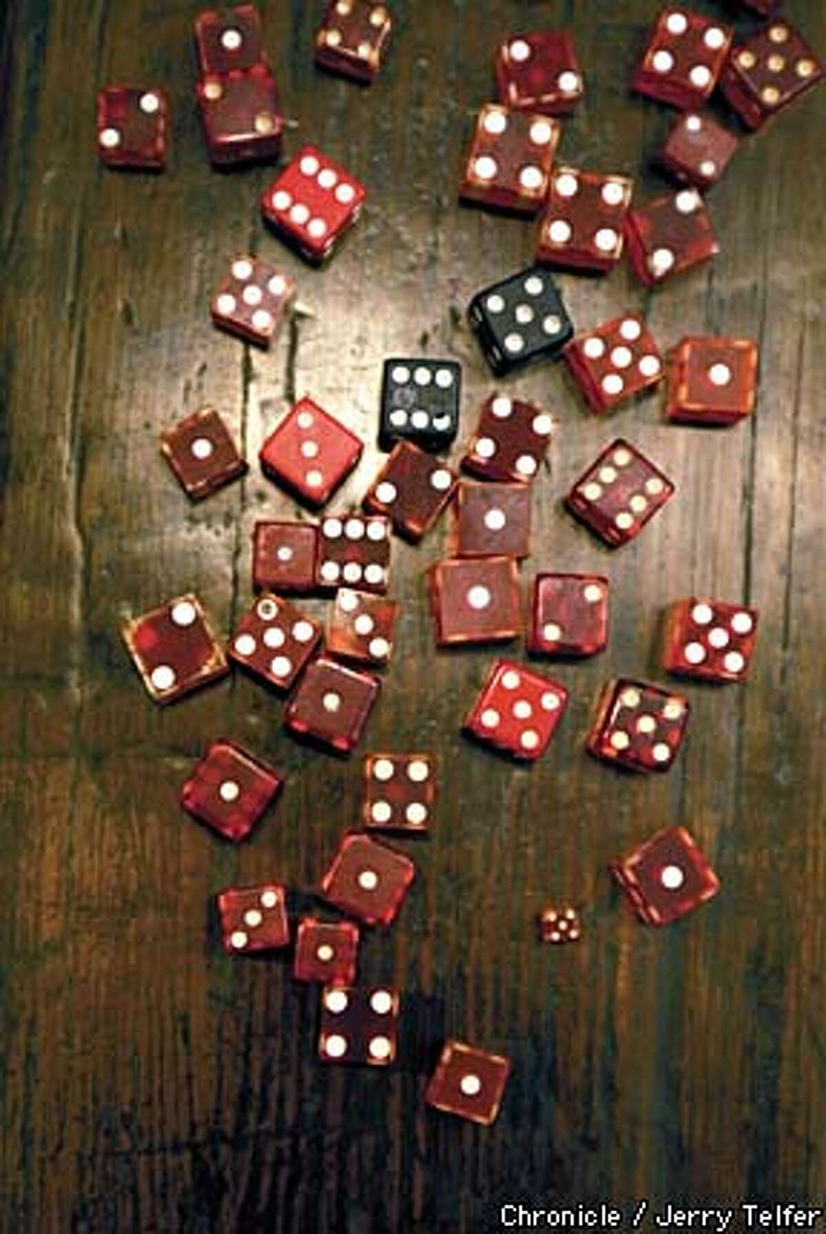 Loaded dice ($1.50 each) are among the oddities at Zedd. Chronicle photo by Jerry Telfer