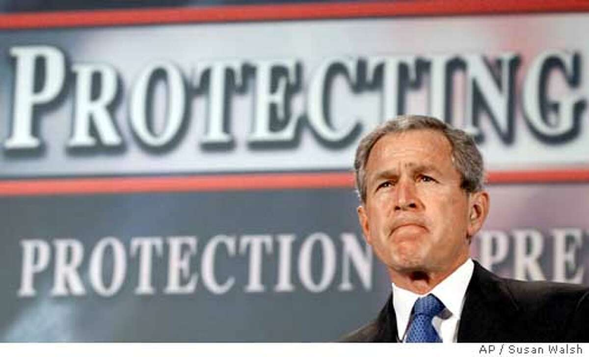 President Bush pauses as he is introduced to deliver his remarks on the Patriot Act in Buffalo, N.Y., Tuesday, April 20, 2004. Making the Patriot Act a theme in his bid to win a second term, Bush is decrying any proposed weakening of the law he calls central to fighting terrorism. For the second day in a row, the president is making a strong public defense of the Patriot Act, this time in Buffalo, the site of recent criminal cases against the Lackawanna Six. The six Yemeni-Americans pleaded guilty to supporting terrorism by briefly attending al-Qaida training camps in Afghanistan. (AP Photo/Susan Walsh)