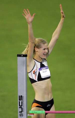 Amy Acuff celebrates after a successful jump in the women's high jump final during the Olympic track and field trials in Sacramento, Calif., Monday, July 12, 2004. Acuff finished in third place.(AP Photo/David J. Phillip) Photo: DAVID J. PHILLIP, Associated Press / AP