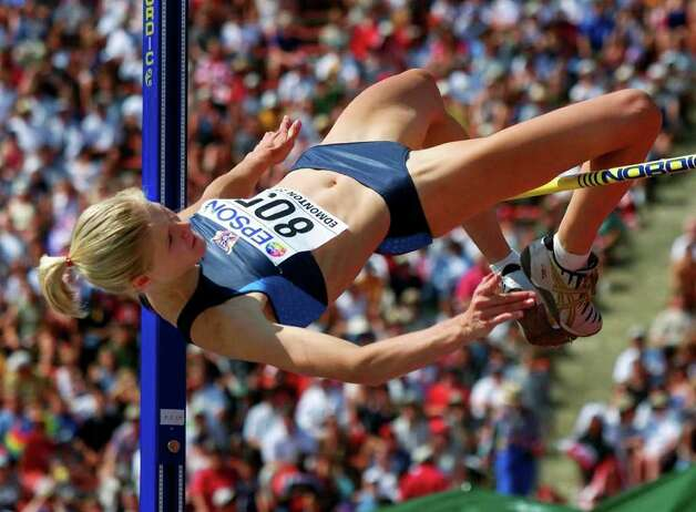Amy Acuff, of the United States, competes in the high jump final Sunday, Aug. 12, 2001, at the World Track & Field Championships at Commonwealth Stadium in Edmonton, Alberta. (AP Photo/Lionel Cironneau) Photo: LIONEL CIRONNEAU, Associated Press / AP