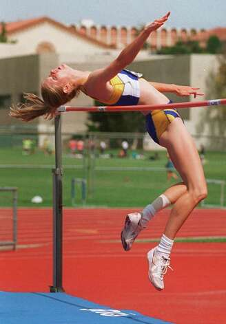 UCLA junior Amy Acuff clears the bar at 6 feet, 3 1/4 inches to win the women's high jump competition at the 1996 Pac 10 Track and Field Championship, Saturday, May 18, 1996, at Ducky Drake Stadium on the UCLA campus in Los Angeles. (AP Photo/Chris Pizzello) Photo: CHRIS PIZZELLO, Associated Press / AP