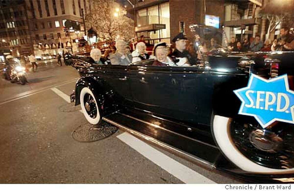 Survivors of San Francisco's 1906 earthquake are driven in a classic car during an early morning ceremony on the 98th anniversary of the earthquake Sunday, April 18, 2004, in San Francisco at Lotta's Fountain, a landmark that served as a meeting point for those trying to find families and friends after the 8.3 magnitude quake and its attendant fires. Nine survivors of the earthquake gathered before dawn Sunday to share stories of an event they experienced as babies 98 years ago but which played a lasting role in both their and the city's development. (AP Photo/San Francisco Chronicle, Brant Ward)