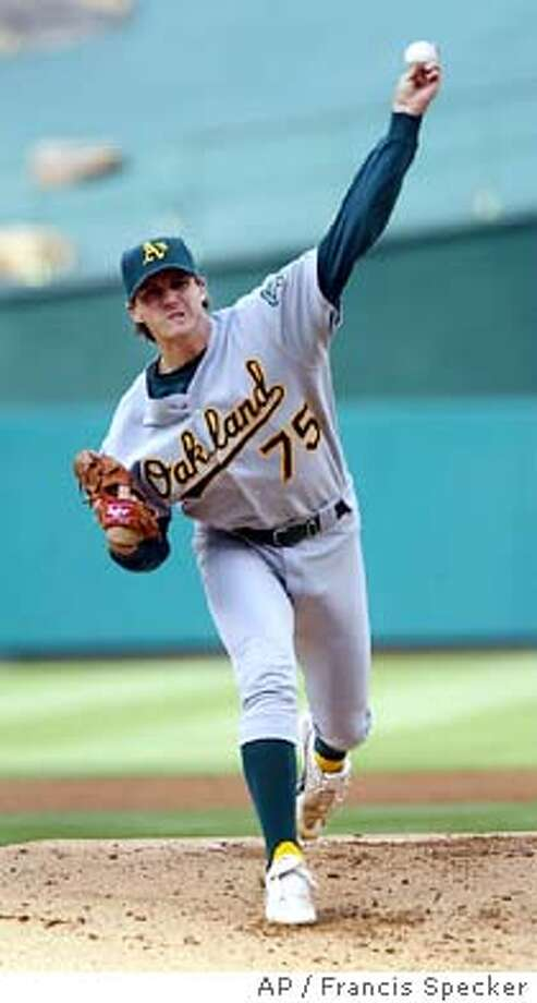 Oakland Athletics' Barry Zito delivers in the first inning against the Anaheim Angels, Sunday, April 18, 2004, in Anaheim, Calif. (AP Photo/Francis Specker)