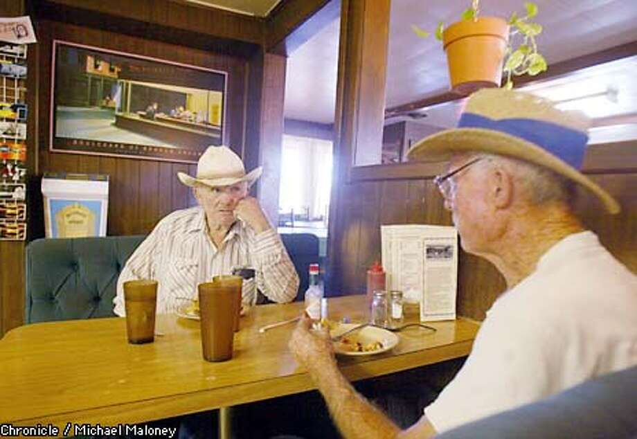 Local ranchers Donny McCormack, left (71) and Jack Garrett (72) discuss the Dean crash while having lunch at the Jack Ranch Cafe near the crash site.  On September 30, 1955 James Dean was killed in a car crash near Cholame in the central valley. A monument along busy Highway 41 900 yards from the crash site was erected by a japanese businessman Seita Ohnishi who was a James Dean fan.  CHRONICLE PHOTO BY MICHAEL MALONEY Photo: MICHAEL MALONEY