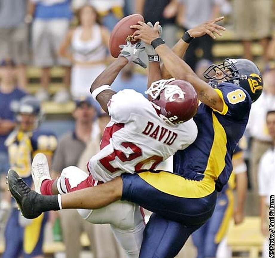 Washington State cornerback Jason David breaks up a pass to California wide receiver LaShaun Ward in the first quarter, Saturday, Sept. 28, 2002 in Berkeley, Calif. (AP Photo/Paul Sakuma) Photo: PAUL SAKUMA