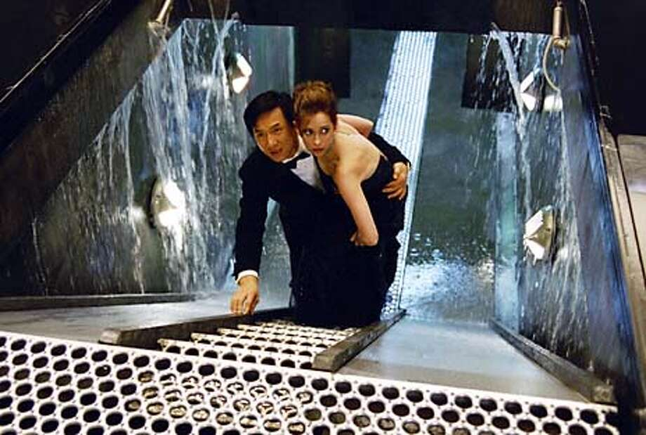 Jimmy Tong (JACKIE CHAN) becomes an unwitting secret agent with an equally inexperienced rookie partner, Del Blaine (JENNIFER LOVE HEWITT), in DreamWorks Pictures� action comedy THE TUXEDO.  Photo: George Kraychyk Photo: HANDOUT