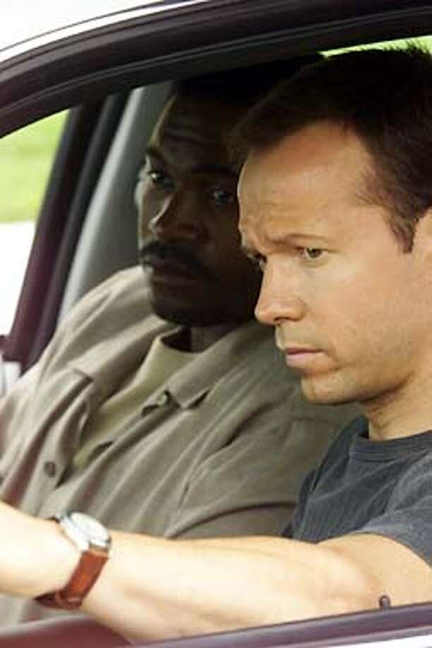 "BOOMTOWN -- NBC Series -- ""Pilot Episode"" -- Pictured: (l-r) Mykelti Williamson as detective ""Fearless"" Bobby Smith, Donnie Wahlberg as detective Joel Sears -- A DRIVE BY SHOOTING IN THE CITY OF ANGELS BRINGS OUT A GROUP OF COPS WHO VIEW THE CRIME FROM THEIR OWN UNIQUE PERSPECTIVES IN THE SERIES PREMIERE -- NBC Photo by: Chris Haston Photo: HANDOUT"