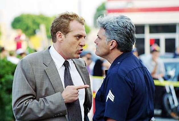 "copyright: ""Mini Mall"" -- ROBBERY HOMICIDE DIVISION stars Tom Sizemore (left), as the detective who heads the Robbery and Homicide Division of the present-day Los Angeles Police Department, in a compelling drama to premiere this fall on Fridays (10:00-11:00 PM, ET/PT) on the CBS Television Network. copyright: Photo: Randy Tepper/CBS  �2002 CBS WORLDWIDE INC. All rights reserved. Photo: RANDY TEPPER"