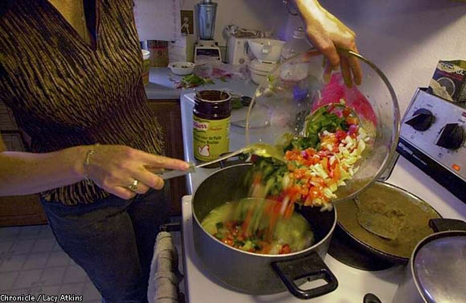 "Hot, Hot, Hot: Marisol Jimenez makes 7-Chile Salsa for Salmon, her contribution to the ""Secrets of Salsa"" cookbook. Chronicle photo by Lacy Atkins"
