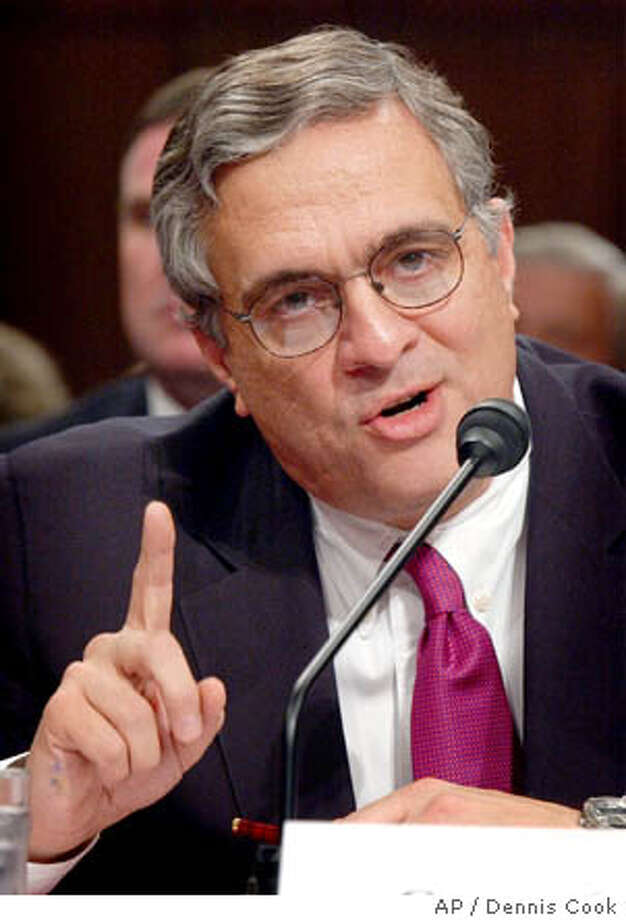 CIA director George Tenet makes his opening statement at the start of his testimony before the commission investigating the Sept. 11 attacks Wednesday, April 14, 2004, on Capitol Hill in Washington. (AP Photo/Dennis Cook) Photo: DENNIS COOK