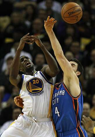 Golden State Warriors' Ekpe Udoh (20)  battles Oklahoma City Thunder Nick Collison (4) for a rebound during the second half of their NBA basketball game in Oakland, Calif., Friday, January 27, 2012. Photo: Lance Iversen, The Chronicle