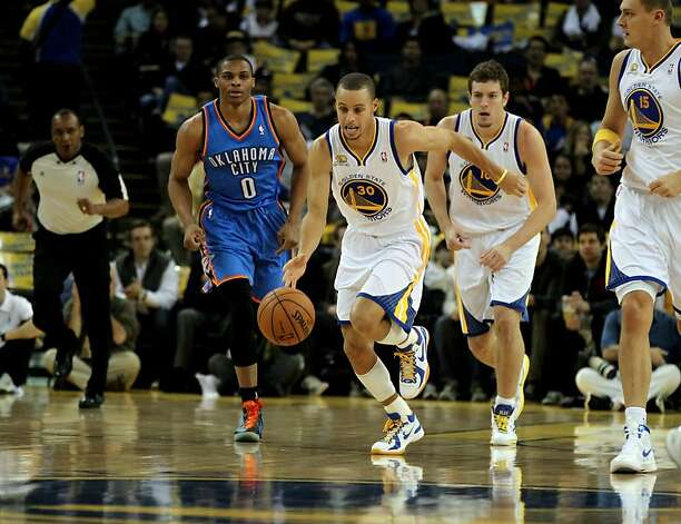 Golden State Warriors' Stephen Curry (30) runs up court on the fast break  against the Oklahoma City Thunder during the first half of their NBA basketball game in Oakland, Calif., Friday, January 27, 2012. Photo: Lance Iversen, The Chronicle