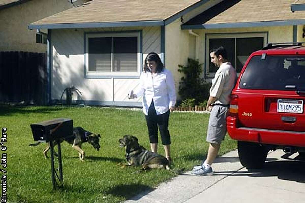 MOVE22-C-19SEPT02-BU- Citrus Heights, CA Home of Victoria and Michael Hull. In their front yard Victoria and Michael with their two dogs Kita (left) and Nana. photo/John O'Hara