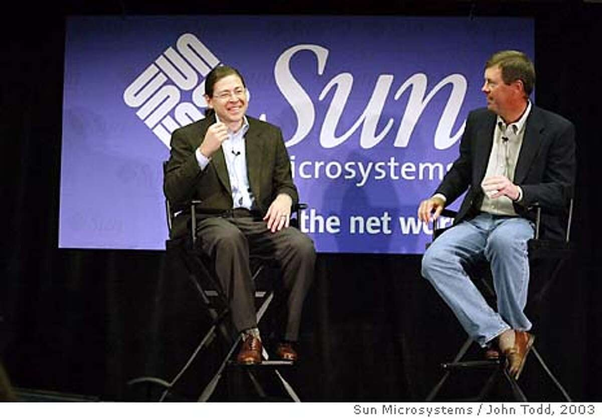 Jonathan Schwartz, left, Executive Vice President of Sun Microsystems, shares a laugh with Sun Microsystems CEO Scott McNealy during a news conference after the keynote address at the Sun Network Conference in San Francisco, California, Tuesday, September 16, 2003. Photographer: John Todd/ Sun Microsystems / John Todd via Bloomberg News.