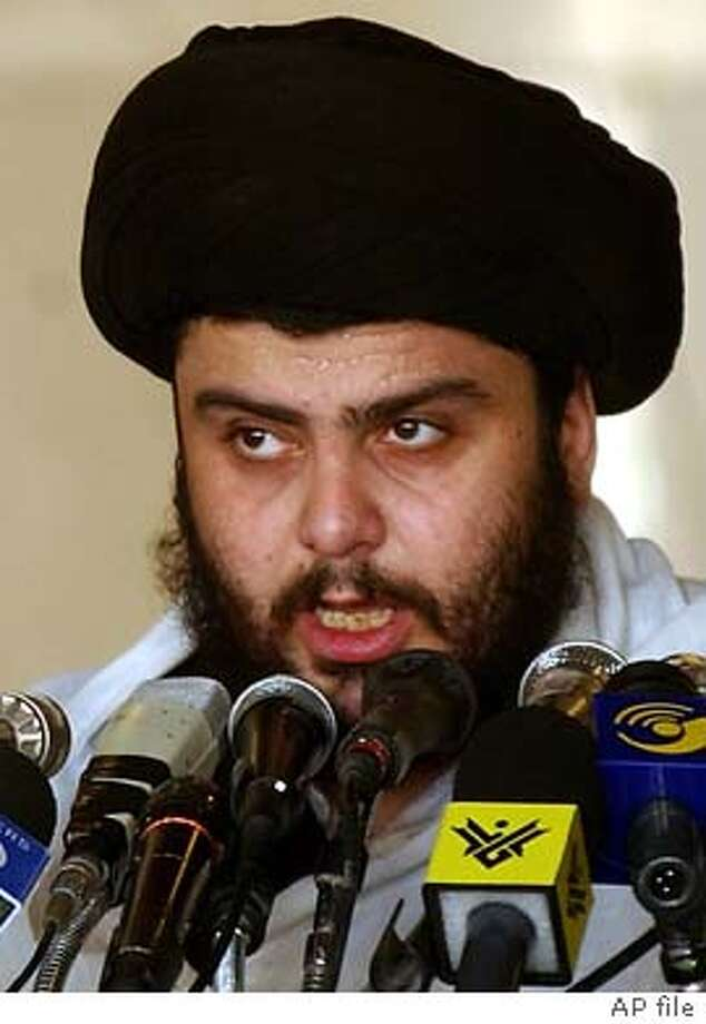 Shiite Muslim firebrand Muqtada al-Sadr leads a Friday sermon at a mosque in the southern Iraqi town of Kufa, on Nov. 7, 2003. Al-Sadr has dropped talk of setting up a rival government, his harsh criticism of senior religious leaders has all but disappeared and the militant cleric now says Saddam Hussein, not America, is the enemy of Iraqis. uqtada al-Sadr's new tone may have more to do with fear of arrest than any decision to abandon his quest for leadership of Iraq's Shiite majority, coalition officials believe. (AP Photo/Pier Paolo Cito) Photo: PIER PAOLO CITO