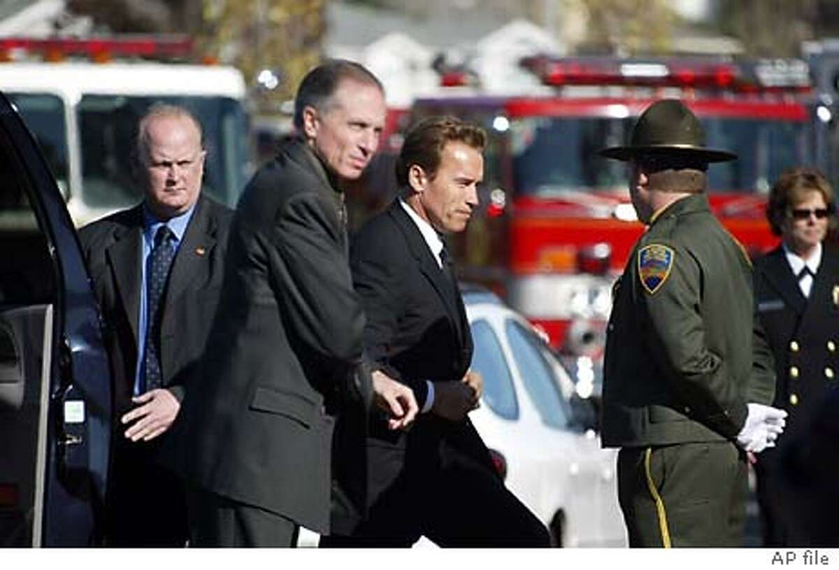 California governor-elect Arnold Schwarzenegger arrives at the Marin County Civic Center in San Rafael, Calif., Wednesday Nov.12, 2003, attending the memorial service for Novato, Calif., firefighter Steven Rucker, who died fighting the Southern California wildfires in October. (AP Photo/Dino Vournas)