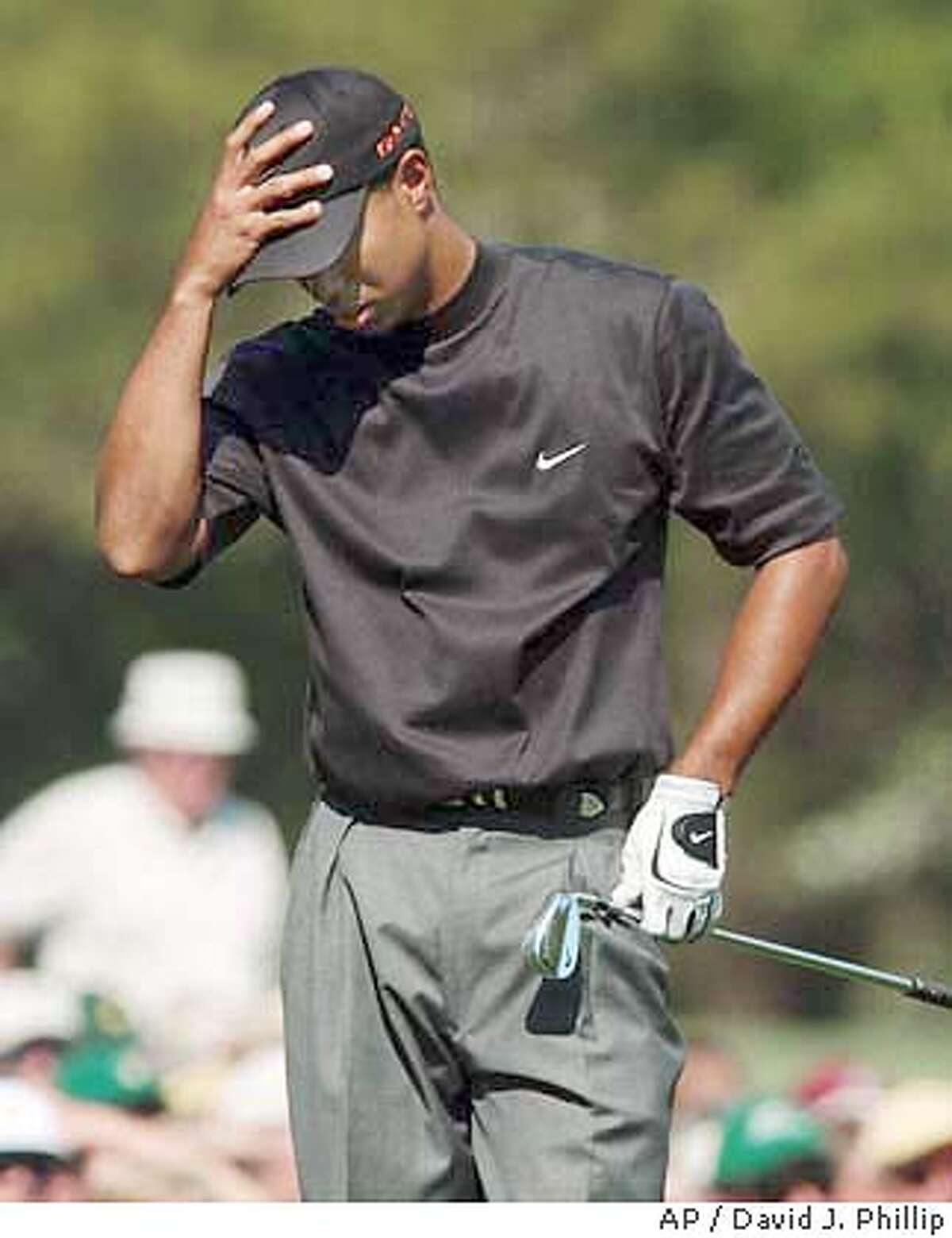 Tiger Woods reacts after hitting on the 11th fairway during the third round of the golf tournament at the Augusta National Golf Club in Augusta, Ga., Saturday, April 10, 2004. (AP Photo/David J. Phillip)