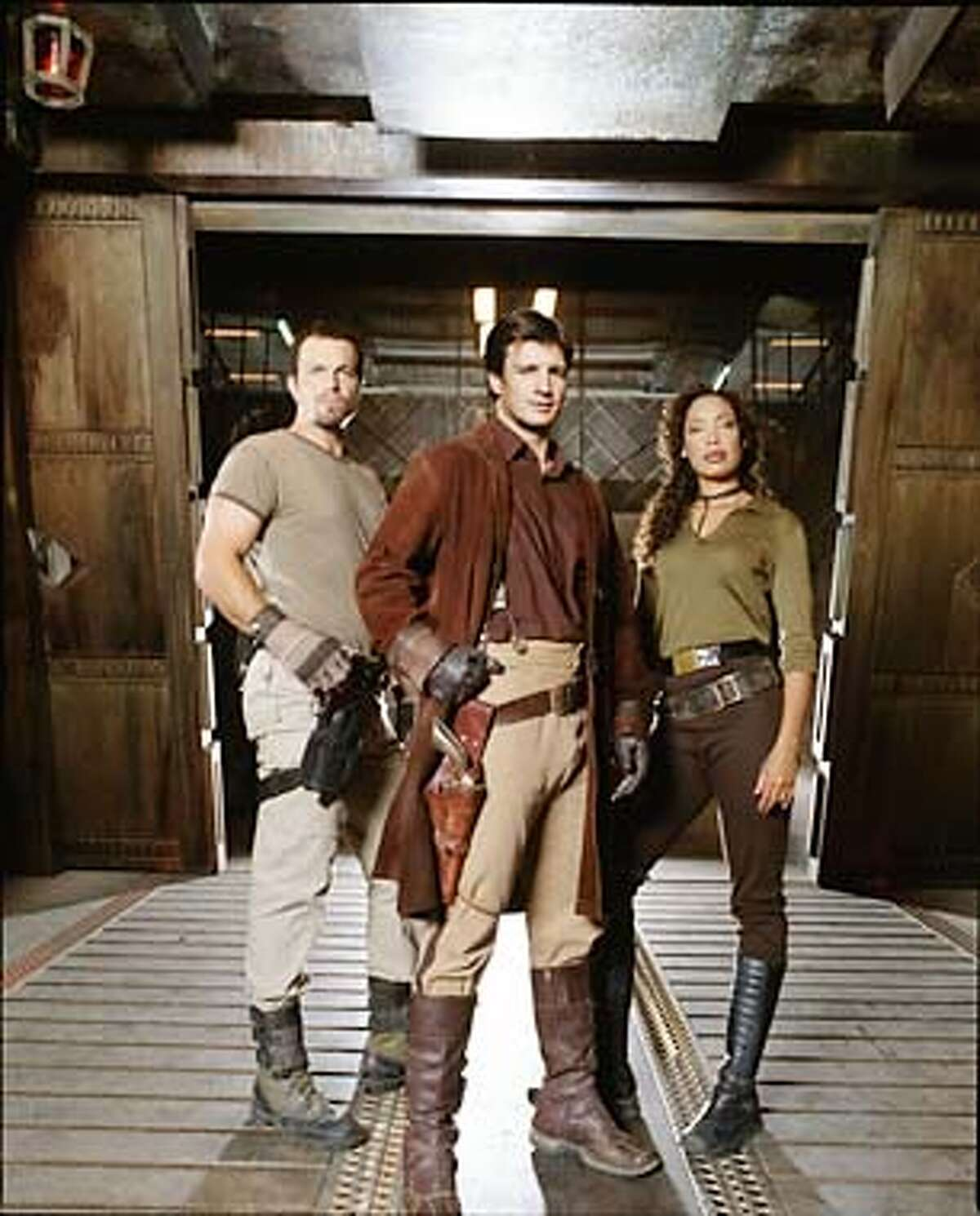 L-R: Adam Balwin, Nathan Fillion and Gina Torres star in the new one-hour sci-fi adventure series FIREFLY premiering Friday, Sep. 20 (9:00-10:00 PM ET/PT) on FOX. ��2002FOX BROADCASTING CR:Michael Lavine/FOX
