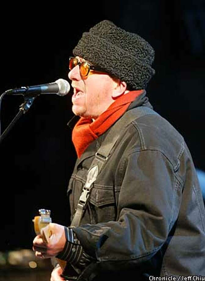 Elvis Costello bundled up for the weather as he played the Mountain Winery in Saratoga with his band, the Imposters. Chronicle photo by Jeff Chiu