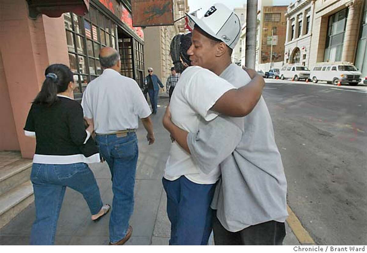 fosterkids130_bw.jpg Darnell Bailey, 20, hugs his mom after a visit to his new apartment...they are outside on Bush Street. Larkin Street Youth Center has started a novel new program for homeless, or potentially homeless, foster kids. It puts them in an apartment or residential hotel room and surrounds them with intensive counseling services. BRANT WARD / The Chronicle