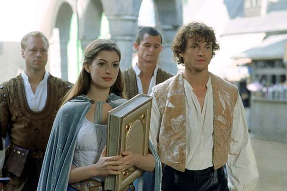 "Anne Hathaway and Hugh Dancy in Tommy O'Haver's ""Ella Enchanted."" (AP Photo/David Appleby) Anne Hathaway and Hugh Dancy share an innocent chemistry in Tommy O'Haver's &quo;Ella Enchanted,&quo; which draws on Cinderella. Photo: DAVID APPLEBY"