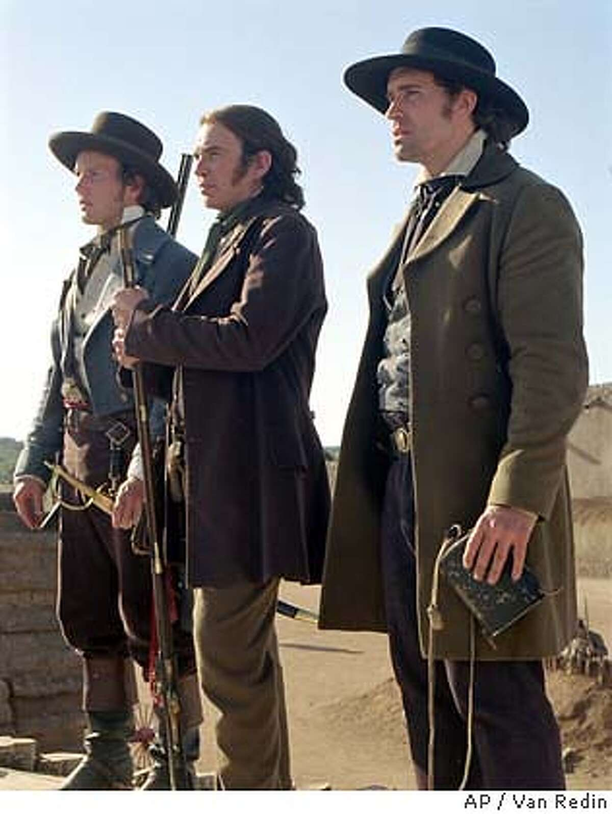 """Lt. Col. William Travis (Patrick Wilson, left), Davy Crockett (Billy Bob Thornton,center) and James Bowie (Jason Patric, right) lead the Texians into the Alamo and into history in """"The Alamo."""" (AP Photo/Van Redin)"""