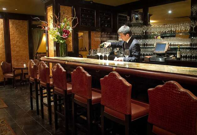 Co-Owner Seigo Takei pours wine at the bar at Keiko Restaurant in San Francisco, Calif., on Friday, January 20th, 2012. Photo: John Storey, Special To The Chronicle