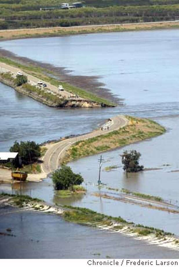; A levee break west of Stockton flooded farm fields on Bacon Island Thursday morning near a railroad line and pipelines that carry drinking water to the San Francisco Bay area. Neither the railroad line or water pipelines were immediately affected. Water officials were working to maintain the quality of drinking water flowing to cities as far away as Los Angeles. Coast Guard Petty Officer Wendy MacLean said about 65 feet of the levee gave way about 8:45 a.m. near the intersection of State Route 4 and West Bacon Island Road, north of Woodward Ferry. 6/3/04  San Francisco Chronicle Frederic Larson Photo: Frederic Larson