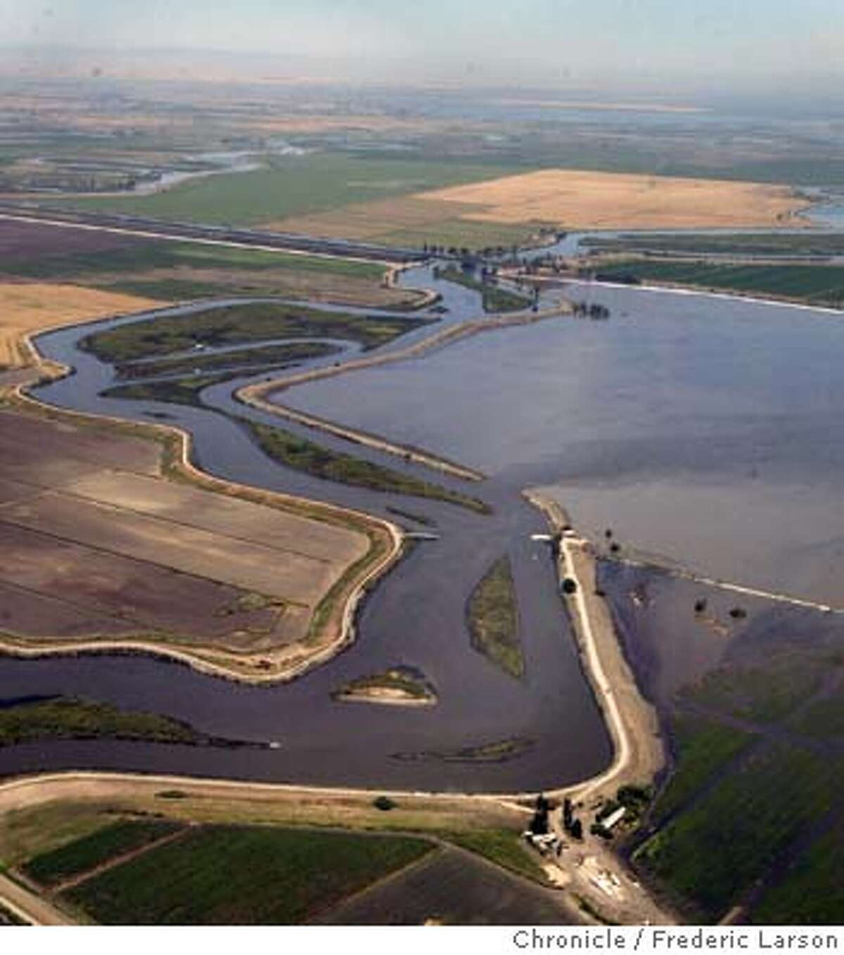 ; A levee break west of Stockton flooded farm fields on Bacon Island Thursday morning near a railroad line and pipelines that carry drinking water to the San Francisco Bay area. Neither the railroad line or water pipelines were immediately affected. Water officials were working to maintain the quality of drinking water flowing to cities as far away as Los Angeles. Coast Guard Petty Officer Wendy MacLean said about 65 feet of the levee gave way about 8:45 a.m. near the intersection of State Route 4 and West Bacon Island Road, north of Woodward Ferry. 6/3/04 San Francisco Chronicle Frederic Larson
