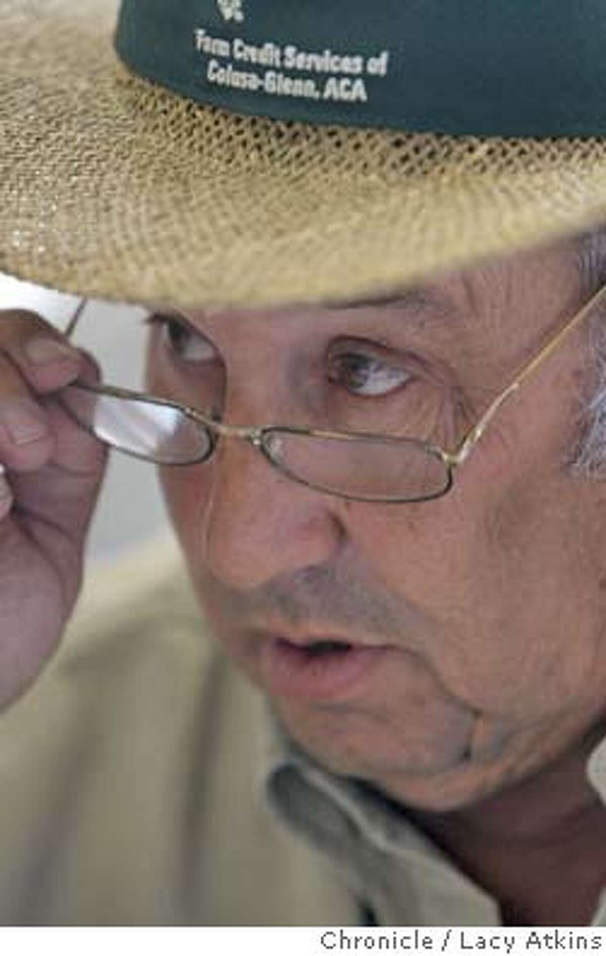 Joe Carrancho, a rice farmers state their views of the California Rice Commission approving a plan to plant genetically engineered rice, at their farms in Glenn County, April 6, 2004. LACY ATKINS / The Chronicle