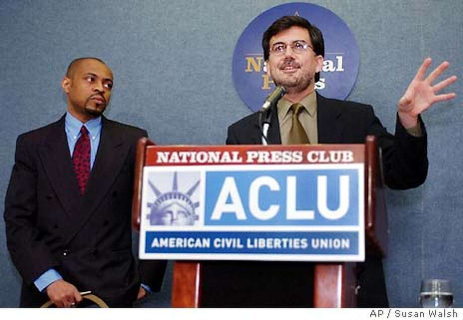 David C. Fathi, right, an attorney with the American Civil Liberities Union's National Prison Project, speaks during a news conference at the National Press Club in Washington, Tuesday, April 6, 2004, as ACLU staff attorney Reginald T. Shuford, left, looks on. Fathi is one of several plaintiffs who is involved in the ACLU's challenge to the list of travelers that the government has barred from flying because they're considered a threat. (AP Photo/Susan Walsh) Photo: SUSAN WALSH
