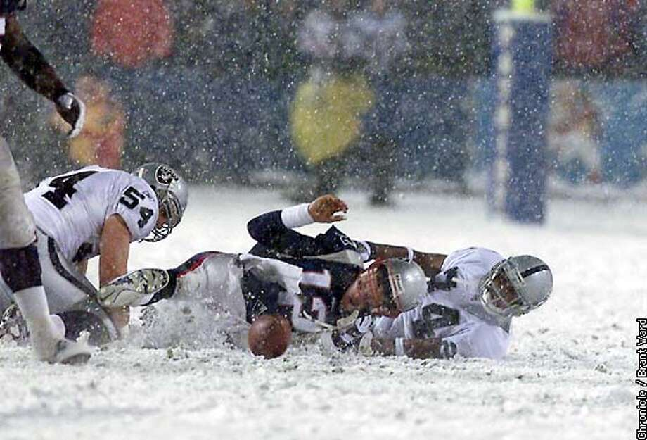 RAIDERS12-19JAN02-SP-BW--The Patriots Tom Brady fumbled the ball in the fourth quarter, but it was ruled that it was a forward pass and the Patriots got the ball again...a big break for New England. By Brant Ward/Chronicle ALSO RAN 03/17/2002