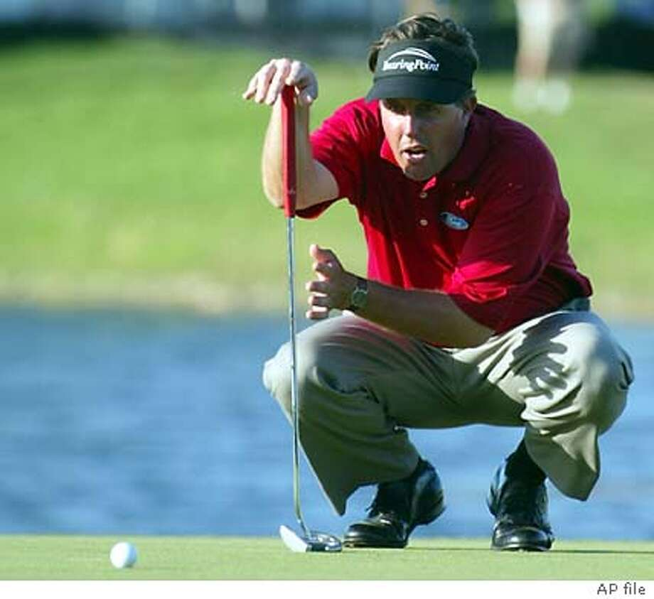 ** ADVANCE FOR WEEKEND EDITIONS APRIL 3-4 ** FILE ** Phil Mickelson lines up his putt on the 18th hole during the second round of the Ford Championship at Doral in this March 5, 2004 photo, in Miami. The 68th Masters Tournament will be played April 8-11 at Augusta National Golf Club in Augusta, Ga.(AP Photo/Wilfredo Lee) Photo: WILFREDO LEE