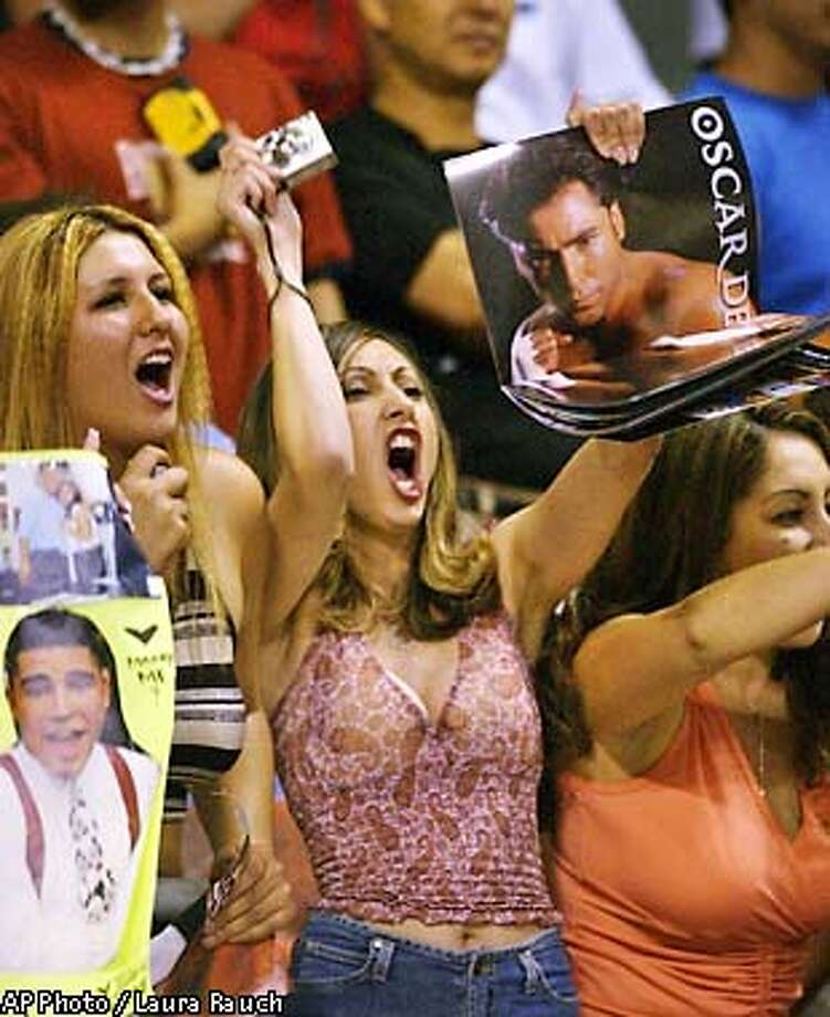 Fans of boxer Oscar De La Hoya greet his arrival for official weigh-in ceremonies at the Mandalay Bay Resort & Casino in Las Vegas, Friday, Sept. 13, 2002. De La Hoya is scheduled to meet opponent Fernando Vargas in a super welterweight championship bout Saturday. (AP Photo/Laura Rauch) Photo: LAURA RAUCH