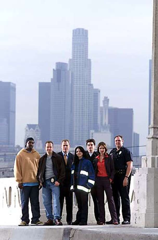 """Boomtown'' stars (from left) Mykelti Williamson, Donnie Wahlberg, Neal McDonough, Lana Parrilla, Jason Gedrick, Nina Garbiras and Gary Basaraba."
