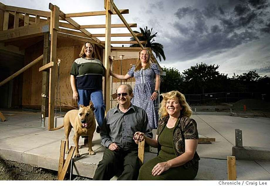 Julie Nord (front right) and her husband, Don Clark (front left) and Julie's sisters, Heidi Nord Grinnell (back left) and Nancy Nord Kanagy (back right) at the construction site of their new restaurant in Yountville called the Wine Garden. The Nord, longtime Napa Valley grapegrowers, are branching out to make their own wines and promote the wines made from those who buy their grapes in their new restaurant. Their dog is named Ginger. Event on 5/27/04 in Yountville. Craig Lee / The Chronicle Photo: Craig Lee