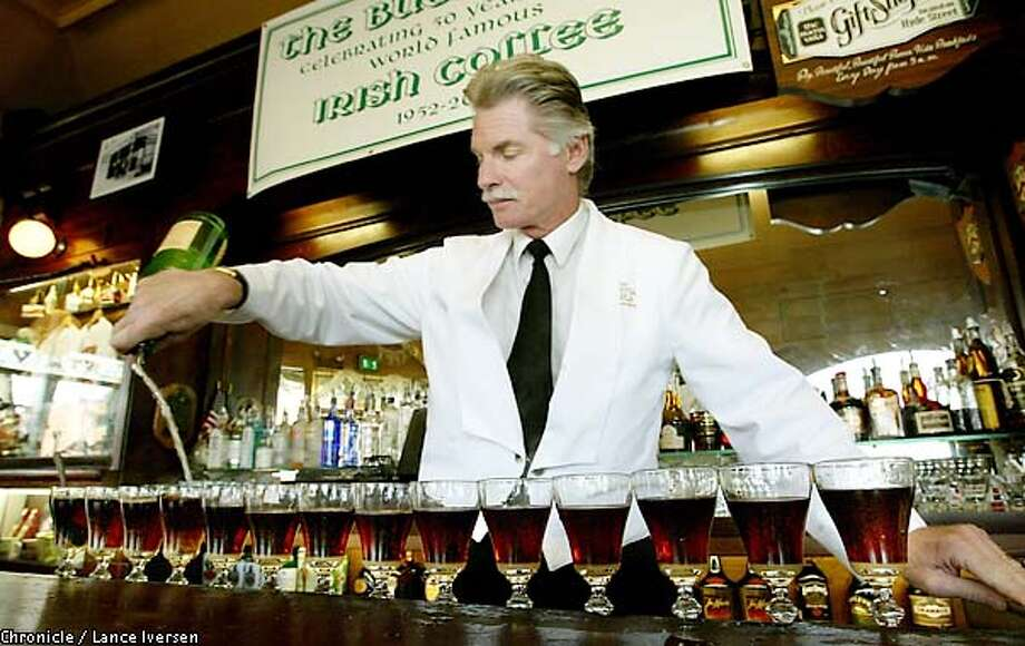 Larry Nolan a 30 year veteran of the Buena Vista Cafe, pouring Irish Coffee's completes a line of 16 as they celibate 50 years. The late Chronicle columnist Stan Delaplane convinced the owners of Buena Vista cafe to serve for the first time Nov 1952 Irish Coffee. By LANCE IVERSEN/SAN FRANCISCO CHRONICLE Photo: LANCE IVERSEN