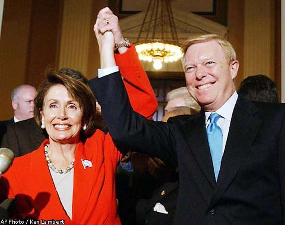 Rep. Nancy Pelosi, D-Calif., left, newly elected House Minority Leader celebrates with former leader Rep. Richard Gephardt, D-Mo., right, on Capitol Hill, Thursday, Nov. 14, 2002, in Washington. In choosing Pelosi on a 177-29 vote, Democrats tasked the veteran California congresswoman with reviving a party stunned by election setbacks and facing a political landscape in which the White House and both houses of Congress are controlled by Republicans. (AP Photo/Ken Lambert) Photo: KEN LAMBERT