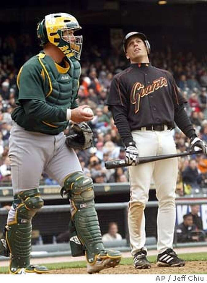 San Francisco Giants' Brian Dallimore, right, looks up after striking out to end the game in the bottom of the ninth inning of their 5-5 tie with the Oakland Athletics in San Francisco on Sunday 4, 2004. At left is Oakland Athletics catcher Mike Rose. (AP Photo/Jeff Chiu) Photo: JEFF CHIU