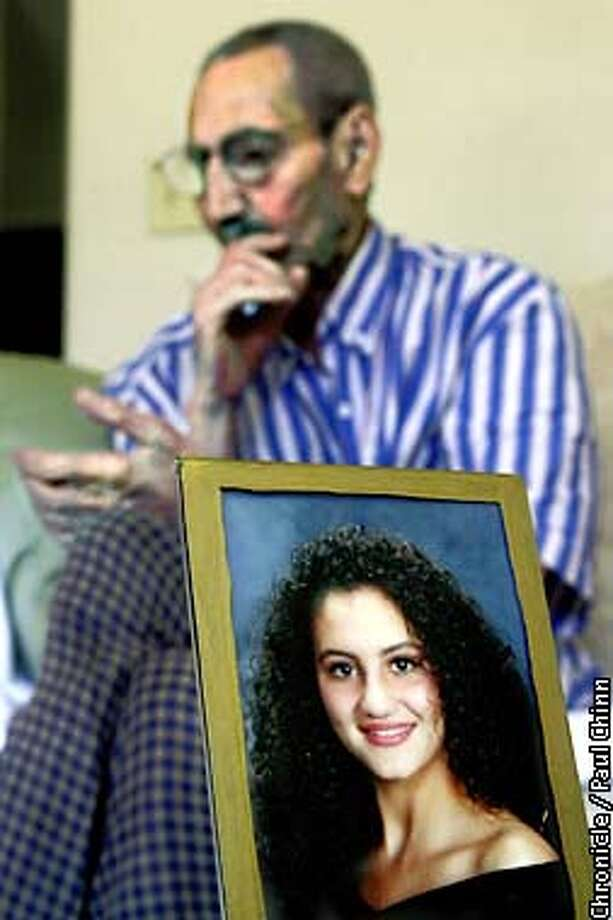 A high school photograph of Dina Ramaha is displayed in front of her grandfather Said Ramahe (cq) at her family's Antioch home. Ramaha is stranded in Israel trying to return to the U.S. but officials won't allow her to leave because her mother holds a Palestinian ID card. Her grandfather went through the same ordeal earlier this summer and had to depart through Jordan.  PAUL CHINN/S.F. CHRONICLE Photo: PAUL CHINN