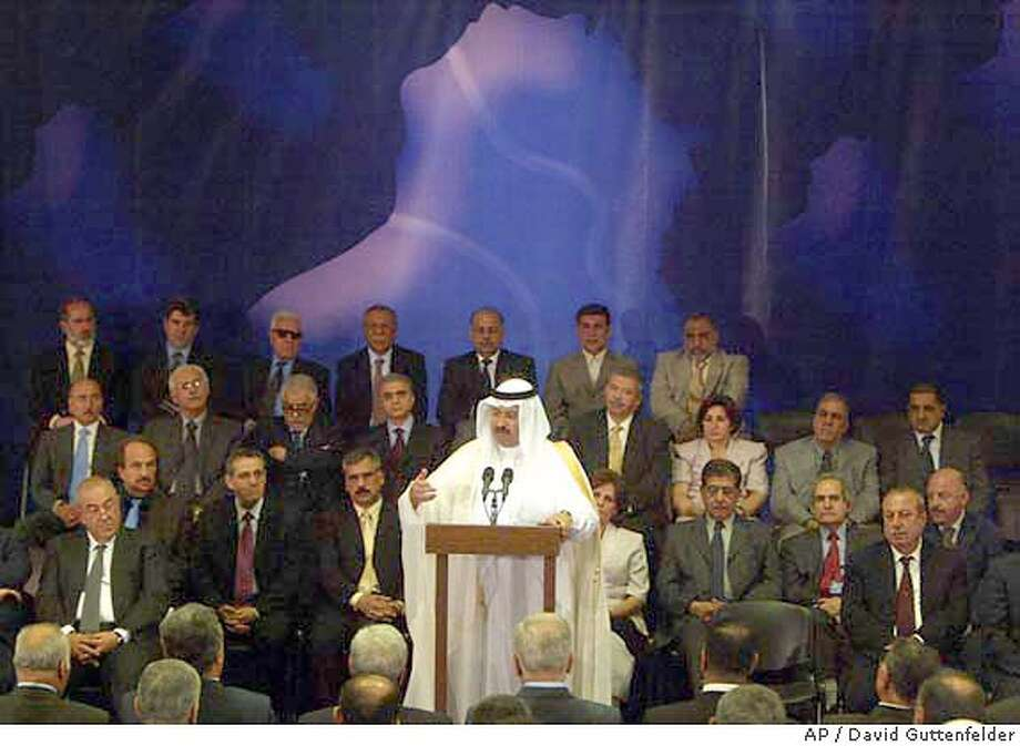 Newly appointed Iraqi president Ghazi Mashal Ajil al-Yawer speaks during a ceremony for the announcement of the new Iraqi interim government in Baghdad Tuesday June 1, 2004. The United States on Tuesday welcomed the formation of a new Iraqi interim government and suggested it would help ease the way for winning support for a U.N. resolution seeking to set the stage for stability in Iraq. (AP Photo/David Guttenfelder) Photo: DAVID GUTTENFELDER
