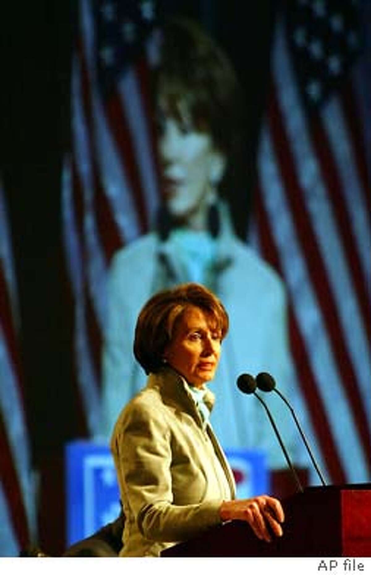 House Minority Leader Nancy Pelosi, D-Calif., addresses the Democratic National Committee at the party's winter meeting in Washington, Friday, Feb. 21. 2003. The Democratic National Committee held the winter meeting to discuss the 2004 presidential elections. Pelosi, one of the few speakers at the meeting who has not announced a White House bid, called on Democrats ``to expose the rhetorical gap between George Bush's lofty rhetoric and the harsh reality of his policies.'' (AP Photo/Charles Dharapak) Photo caption