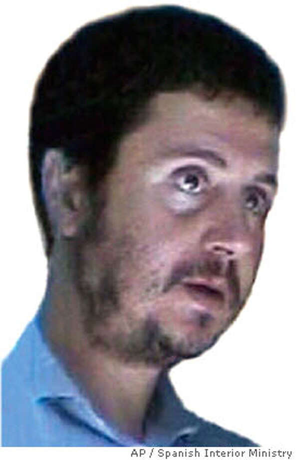** FILE ** Tunisian Sarhane Ben Abdelmajid Fakhet, seen in this undated handout photo released by police in Madrid, Sunday, April 4, 2004, who is described by Spanish authorities as the leader of the group suspected of carrying out the March 11 Madrid train attacks that killed 191 people. According to the Spanish Interior Minister Angel Acebes, Abdelmajid Fakhet was one of the four men who blew themselves up as police prepared to storm their Madrid apartment Saturday night, April 3, 2004. (AP Photo/Spanish Police/EFE)