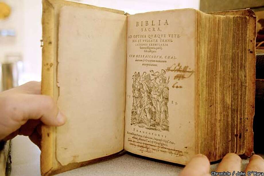 This copy of the Latin Vulgate Bible, at California Collectible Books in Martinez, was published in Frankfurt in 1585. The book sells for $2,500. Chronicle photo by John O'Hara