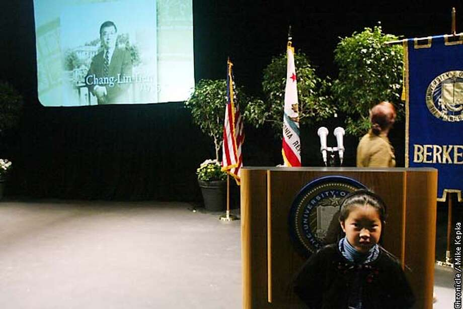 UC Berkeley Chancellor Chang-Lin Tien's grandaughter, Kylie Tien, 7, hides by the podium in Cal's Zellerbach Hall after after a memorial service for one of Cal's greatest members. BY MIKE KEPKA/THE CHRONICLE Photo: MIKE KEPKA