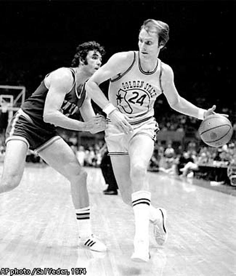 California Golden State Warriors Rick Barry (24) rounds the corner and heads for the basket and two points in the first half against the New York Knicks at Oakland, Calif. March 14, 1974. Knicks Dave DeBusschere (22) defends. (AP photo/Sal Veder) Photo: SAL VEDER