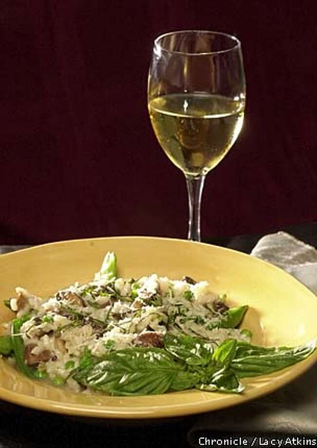 Risotto: This basic rice dish may be made with whatever vegetables are in season. Chronicle photo by Lacy Atkins