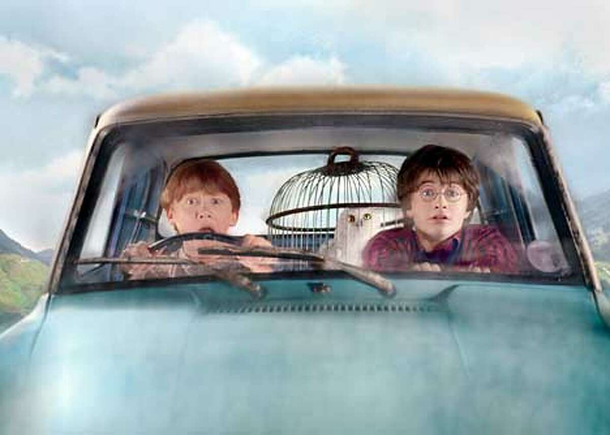 """(L-r) Ron (RUPERT GRINT), Hedwig and Harry (DANIEL RADCLIFFE) in the flying Ford Anglia in Warner Bros. Pictures' """"Harry Potter and the Chamber of Secrets."""" PHOTOGRAPHS TO BE USED SOLELY FOR ADVERTISING, PROMOTION, PUBLICITY OR REVIEWS OF THIS SPECIFIC MOTION PICTURE AND TO REVMAIN THE PROPERTY OF THE STUDIO. NOT FOR SALE OR REDISTRIBUTION HARRY POTTER and all related indicia are trademarks of and �2002 Warner Bros. All Rights Reserved. Harry Potter Publishing Rights �J.K.R."""