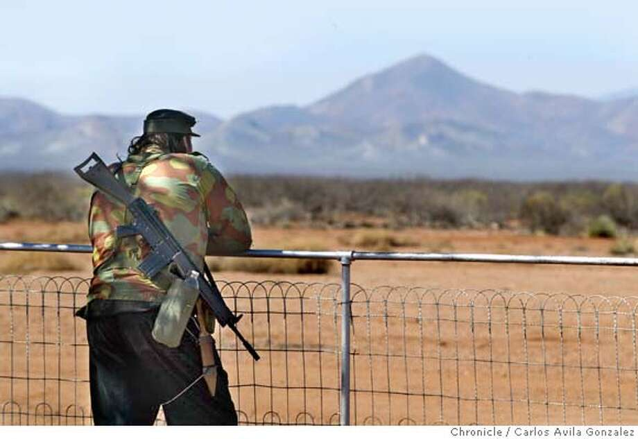 """""""Tiny"""" keeps a watchful eye out from the farm on Casey Nethercott's property outside Douglas Arizona on Wednesday, February 25, 2004. Along the Arizona border with Mexico, independent citizens have taken the issue of illegal immigration into their own hands, taking up arms, night scopes, and paramilitary tactics to protect the U.S. from the hundreds of thousands that struggle to find a better life. At Casey Nethercott's property, volunteers come to join a group called """"Ranch Rescue,"""" to protect the Arizona landowner's property. Photo taken on 02/25/04 in Douglas, AZ Photo by Carlos Avila Gonzalez/ The San Francisco Chronicle. Photo: Carlos Avila Gonzalez"""